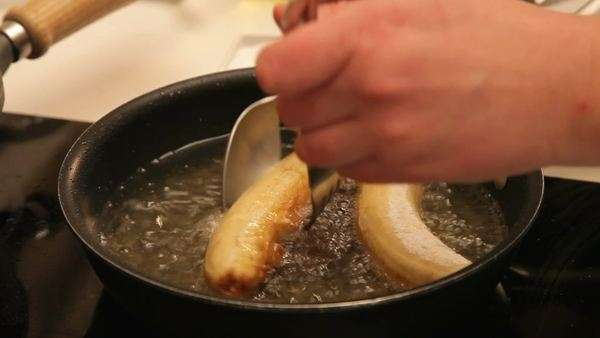 Frying two bananas and turning them around Royalty-free stock video