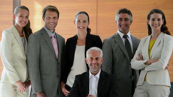 Business team of six people turning head to face camera then smiling. Royalty-free stock video