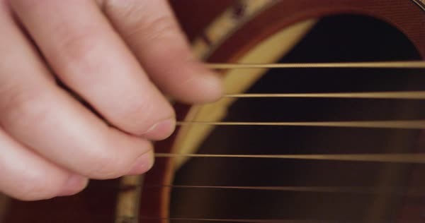 Hand-held shot of a person playing a guitar with fingers Royalty-free stock video