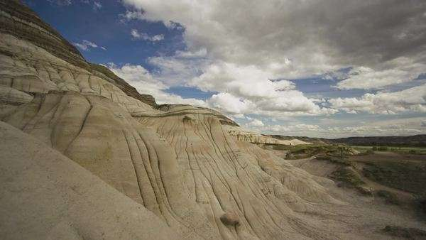 Timelapse of tourists walking at barren hills in Drumheller, Alberta Royalty-free stock video