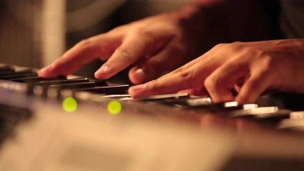 Handheld close-up of a person playing melody on keyboards Royalty-free stock video