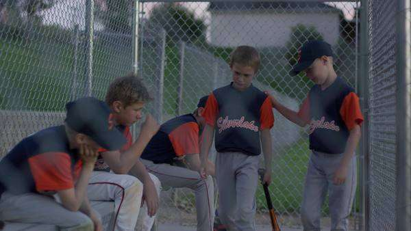 Medium shot of baseball team comforting unhappy batter Rights-managed stock video