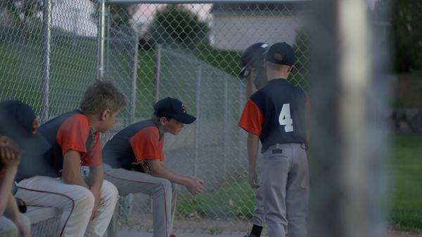 Medium slow motion shot of baseball team comforting unhappy batter Rights-managed stock video