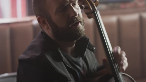 Close up shot of man playing cello in bar Royalty-free stock video