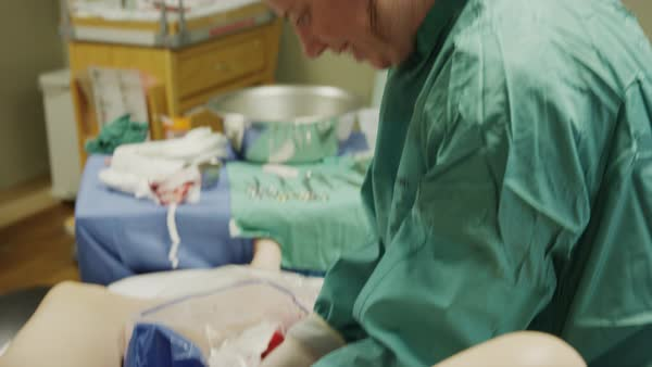 Close up shot of doctor holding placenta of mother after childbirth Rights-managed stock video