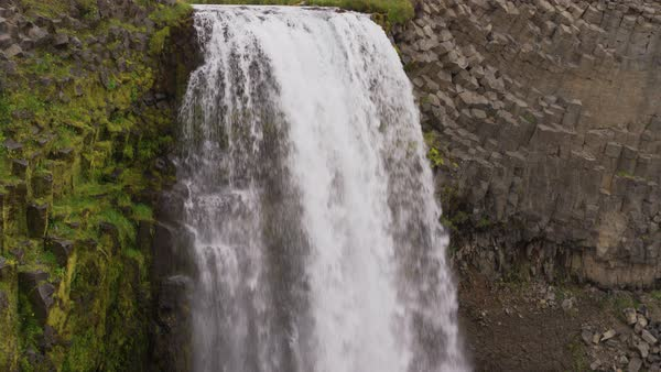 Wide crane shot of waterfall flowing over cliff Royalty-free stock video