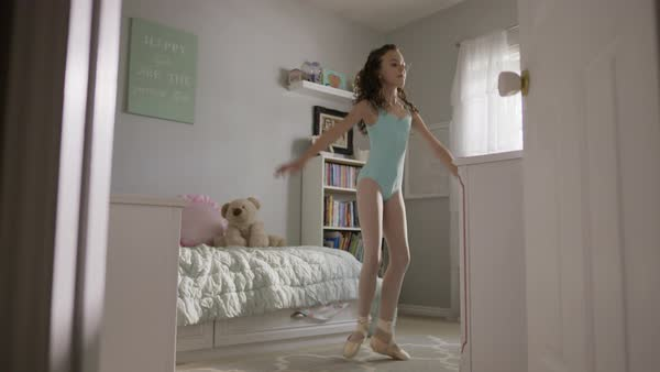 Medium slow motion shot of girl practicing ballet in bedroom Royalty-free stock video