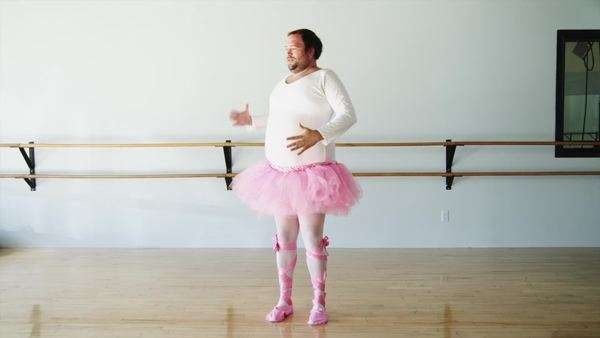 Wide shot of an overweight man wearing ballerina costume practicing in ballet studio / Orem,Utah,USA Royalty-free stock video