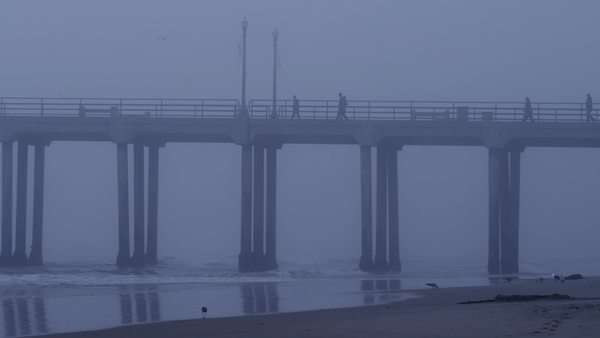 USA, California, Huntington Beach, People on pier over sea at dusk Royalty-free stock video