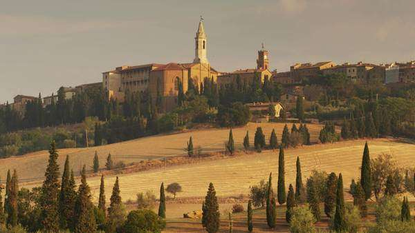 Wide shot of church in Italian hillside town, Tuscany, Italy Royalty-free stock video