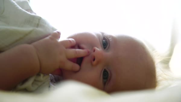 Close-up shot of newborn baby lying in bed Royalty-free stock video