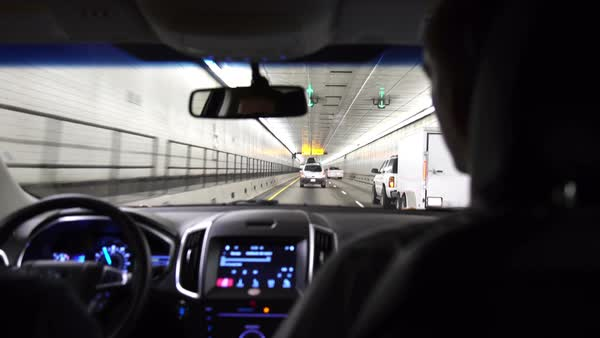 Medium shot of two people sitting in a car in a tunnel Royalty-free stock video