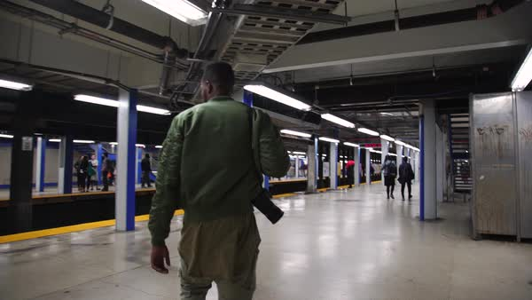 Tracking shot of a man walking at a subway station Royalty-free stock video