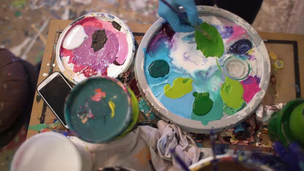 Top view of a person mixing colors on a palette Royalty-free stock video