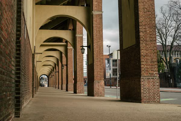 Timelapse of pedestrians walking under arches Rights-managed stock video