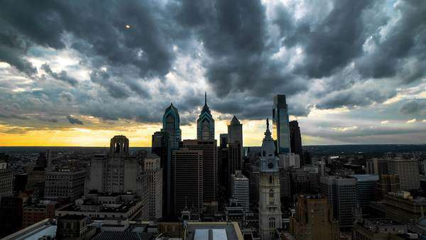 Zooming out shot of thick storm clouds moving above Philadelphia skyline Rights-managed stock video