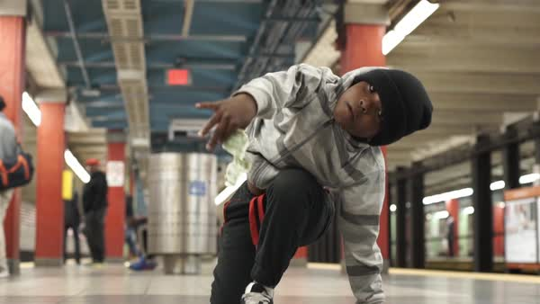 Medium shot of a young boy break dancing in the subway Rights-managed stock video