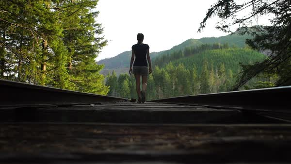 Slow motion of a woman walking on the Vance Creek Bridge in Shelton, Washington Rights-managed stock video