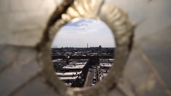 Close up shot of rooftops trough a hole in Philadelphia, PA, USA Rights-managed stock video