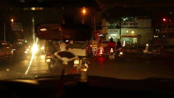 Handheld wide shot of people riding motorbikes in a city Royalty-free stock video