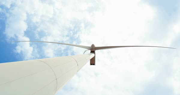 Looking up at windmill turbine against blue sky clean energy Royalty-free stock video