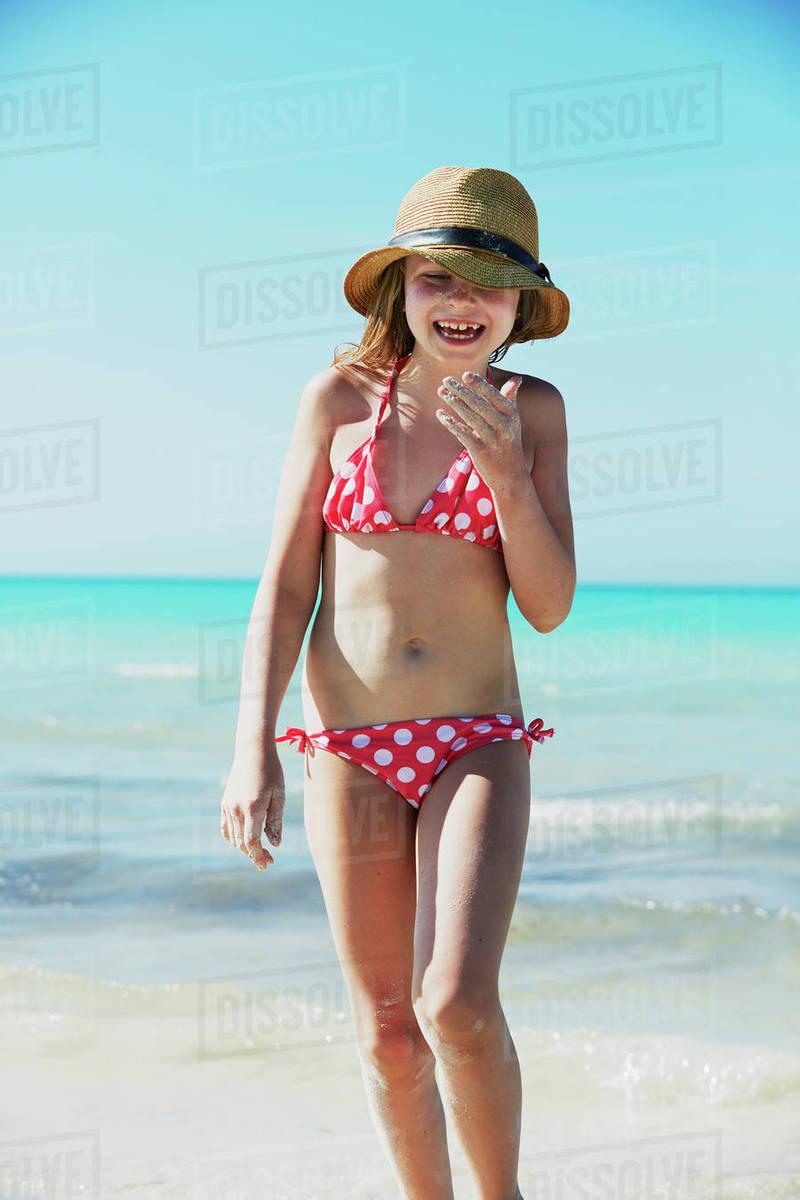 ce4f97cbae Girl wearing bikini walking on beach - Stock Photo - Dissolve