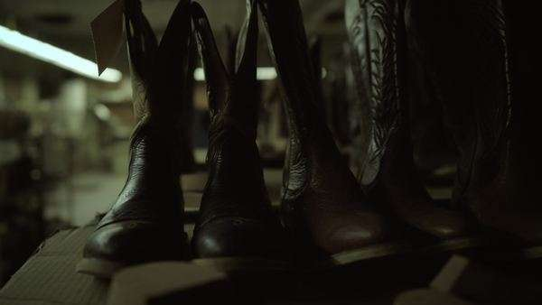 4k Slow dolly along cowboy boots in factory, slow dolly Royalty-free stock video