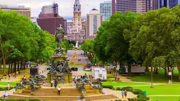 Timelapse of the Benjamin Franklin Parkway with City Hall in the background, from the top of the steps of the Philadelphia Museum of Art. Royalty-free stock video