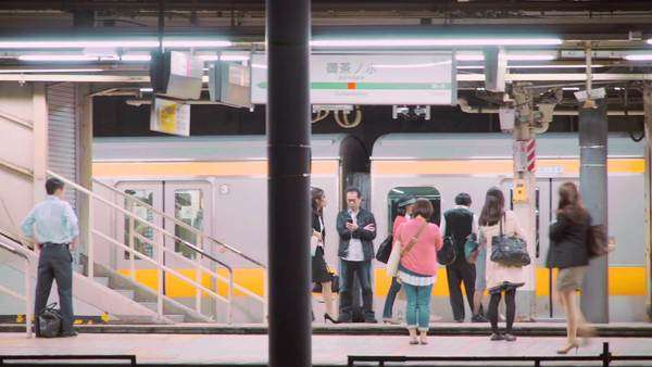 People boarding and exiting trains at the subway station in Tokyo, Japan, panning shot. Royalty-free stock video