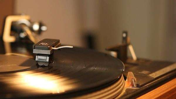 Close-up of a record player playing a vinyl black record. The needle is being put onto the record and removed again. Royalty-free stock video