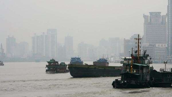 Timelapse of boat traffic on the river at a foggy chinese city Royalty-free stock video