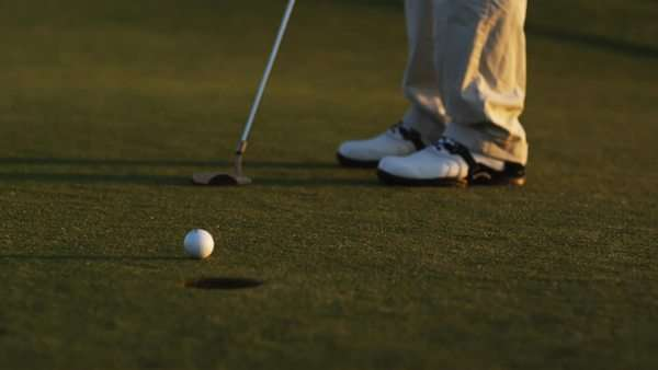 Golfer making a putt Royalty-free stock video
