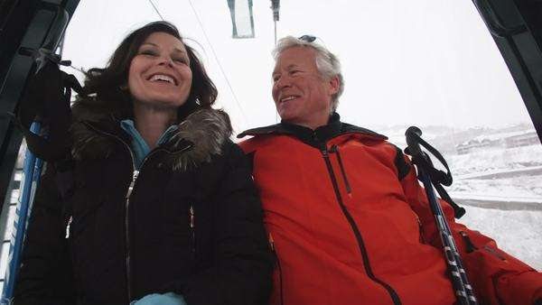 Mature couple on a gondola chair lift at a ski resort Royalty-free stock video