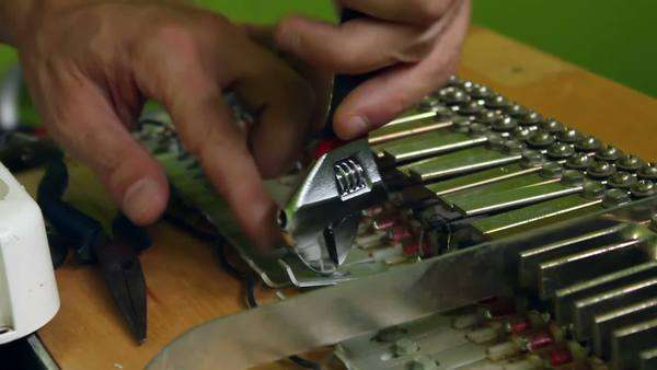 Hands fixing a piano with tools Royalty-free stock video