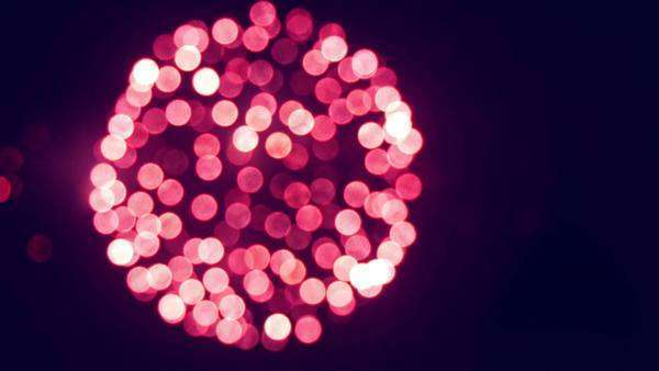 Defocused bokeh firework against night sky. Victory Day Salute on 9th May in Russia 2015. Royalty-free stock video