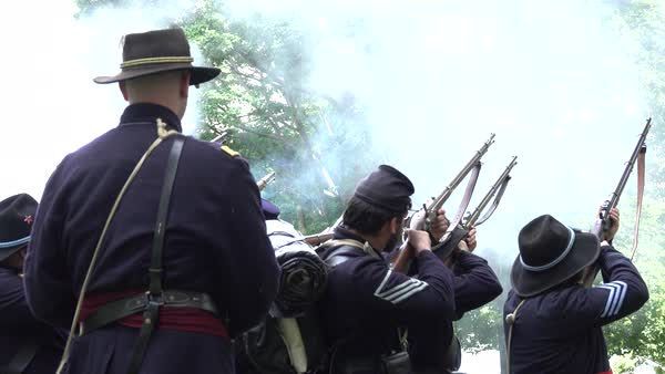 View of Civil War soldiers firing guns in formation (Archive Footage Version) Royalty-free stock video
