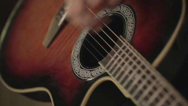 Close up of a young man playing classical guitar Royalty-free stock video