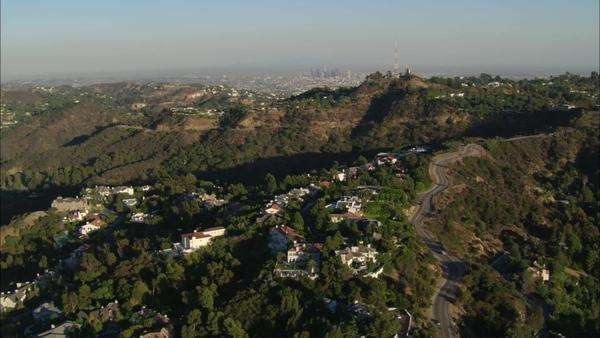 Hollywood Hills California. Hollywood hills and an overview of buildings and city life. Hollywood sign visible in the background. Royalty-free stock video