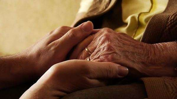 Senior old woman young man hold hand wrinkle skin close up Royalty-free stock video