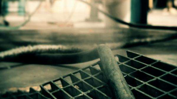 Science fiction feel from this footage of steam emitting from a industrial floor grate. Royalty-free stock video