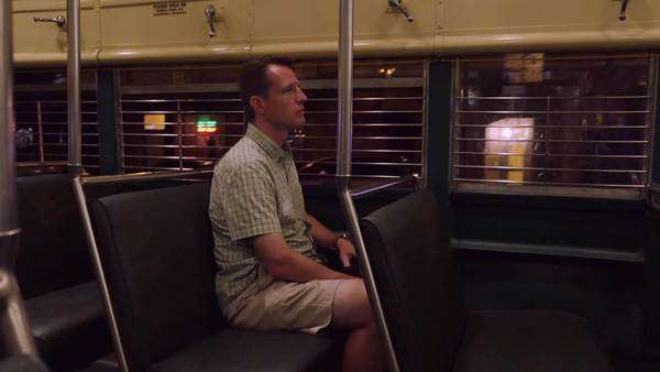 A man rides a San Francisco street car at night.    Royalty-free stock video
