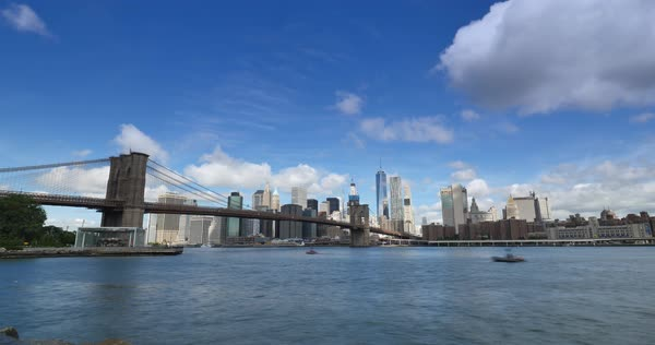 A dramatic summer time lapse view of Lower Manhattan and the Brooklyn Bridge.  	 Royalty-free stock video