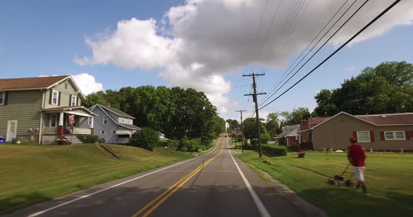 A personal perspective of driving in a typical western Pennsylvania small town or residential neighborhood. Royalty-free stock video