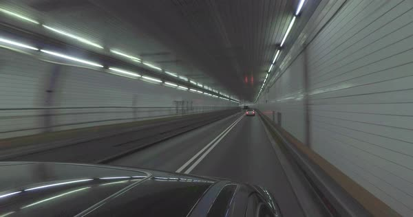 An interior perspective driving inside the Holland Tunnel under the Hudson River between New Jersey and New York City.  	 Royalty-free stock video