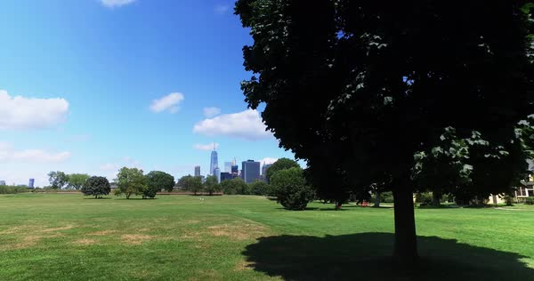 A daytime summer establishing shot of the skyline of lower Manhattan and the Freedom Tower as seen from Governors Island.  	 Royalty-free stock video