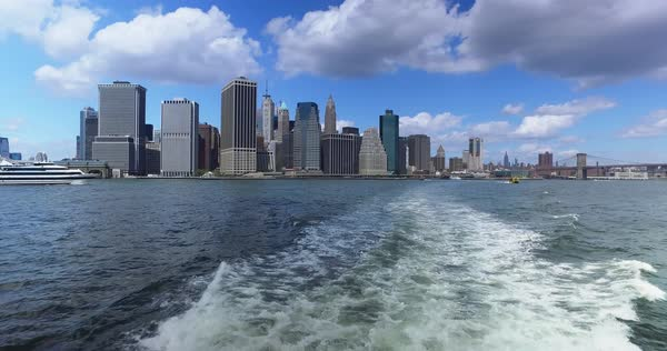 A daytime view of the lower Manhattan skyline and Freedom Tower as seen from the East River Ferry on the way to Governors Island.  	 Royalty-free stock video