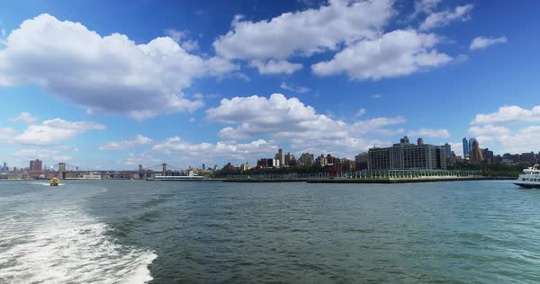 A daytime view of the Brooklyn skyline as seen from the East River Ferry on the way to Governors Island.	 	 Royalty-free stock video