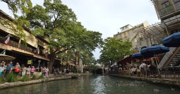 SAN ANTONIO, TX -Circa September, 2016 - A passenger's perspective riding on a gondola past the various restaurants and establishments on the famous San Antonio River Walk.  	 Royalty-free stock video