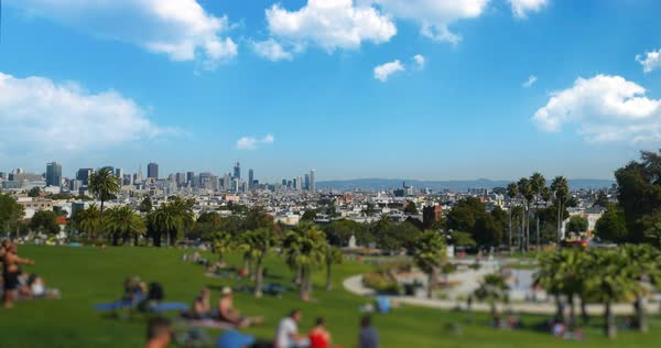A tilt shift establishing shot of Mission Dolores Park with the San Francisco skyline in the distance. Royalty-free stock video