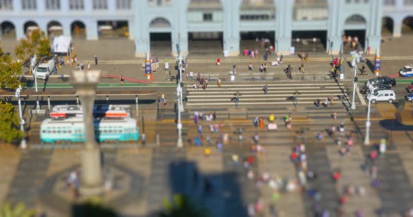 A high angle tilt-shift establishing shot of busy activity on The Embarcadero in front of the Ferry Building. Royalty-free stock video